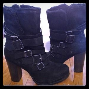 New black heeled boots with buckle detailing.