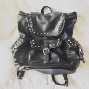 Handbags - Studded leather backpack with buckles