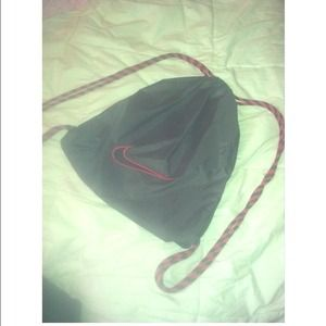 Pink & black Nike drawstring bag