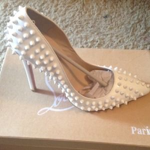 white spiked louboutin pumps