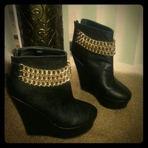 Never worn goregous black booties with gold chain