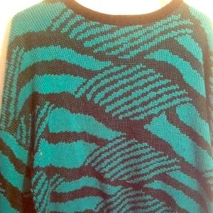 Patterned green knit sweater.