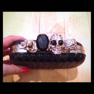 Black clutch with skull rings