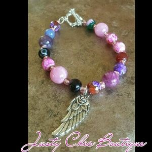 Jewelry - Sold Rose,an wing, gemstones