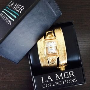 La Mer Accessories - La Mer gold watch NEW in box.