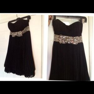 Little black cocktail dress with beaded bow.