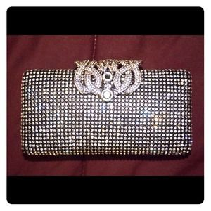 It's a brand new fully embellished clutch