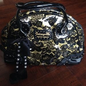 Betsey Johnson Handbags - Yellow and black printed Betseyville bag