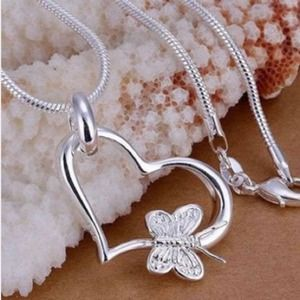 Jewelry - Heart pendant with a butterfly