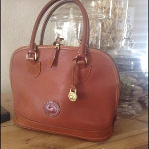 Vintage, tan, all weather leather Dooney & Bourke