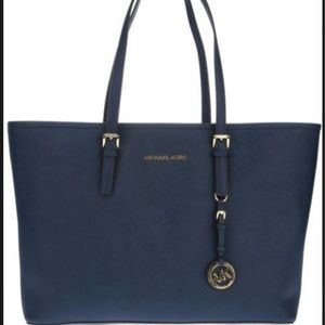 25% off Michael Kors Handbags - Navy blue tote bag from Tracy's ...