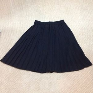 B.C.B.G. Pleated sheer lined skirt. Size S black