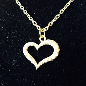 Jewelry - Gold tone heart with crystals.