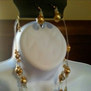 Set of necklace and earrings white and gold beads.