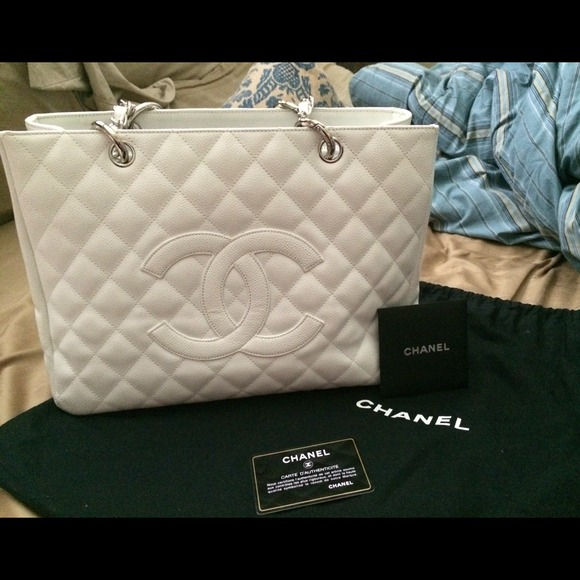 CHANEL Handbags - WHITE CHANEL GST- unsure if I want to let go 90b4a20e0c6fd