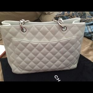 CHANEL Bags - WHITE CHANEL GST- unsure if I want to let go 90fe95a422b8a