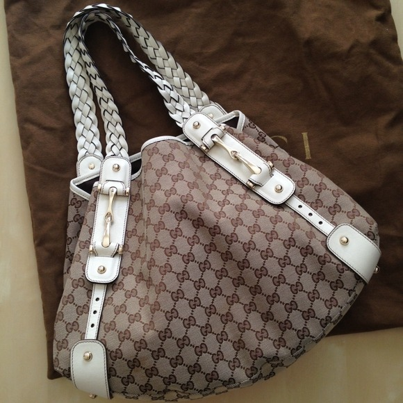 b93a5936ad5 Gucci Handbags - Gucci Pelham GG canvas medium bag