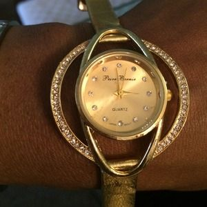 Gold watch with crystals ..