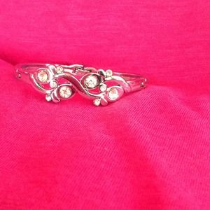 Silver bangle with latch