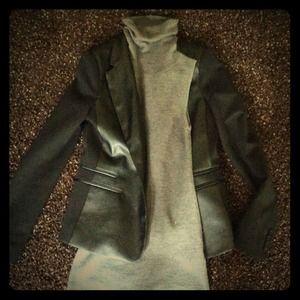 Gray sleeveless turtleneck sweater