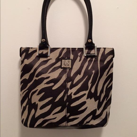 55e39a3f44b3 Anne Klein Handbags - Anne Klein Black Gold Zebra Print Tote Bag