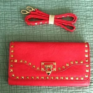 JustFab red studded clutch with cross body strap