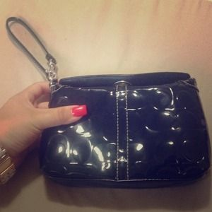 Metallic black coach wristlet