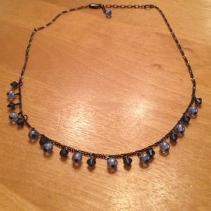 Delicate necklace with beads of blue