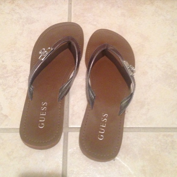 35f87eebd88b Guess Shoes - Super cute brown GUESS flip flops!