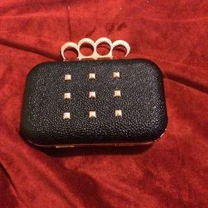 Clutches & Wallets - Edgy black and rose gold clutch