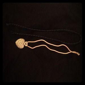 Faux diamond pendant. It's cz. W/two silk cords