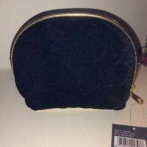 Black velvet and gold makeup bag