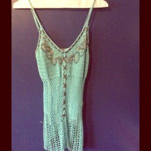 Light blue netted tank.