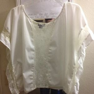 Ivory bat wing top.