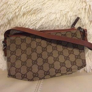 Gucci logo and cognac leather pouchette