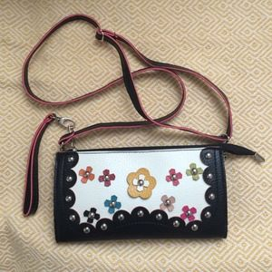 Black clutch/purse with studded flower detail