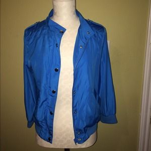 Jacket with buttons and zipper