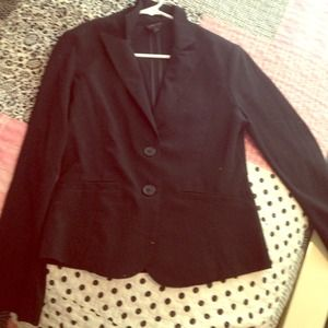 Size small. Black blazer. Buttons down the front