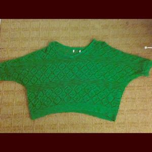 An oversized green knit sweater.