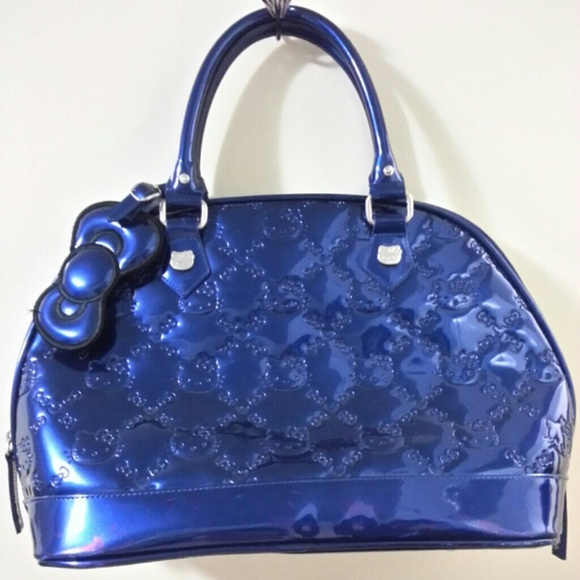 402a64d74 Hello Kitty Handbags - Blue Hello Kitty Embossed Purse