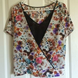 Floral top with cut outs in the back