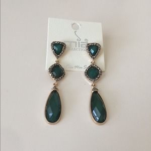 Emerald green earrings.