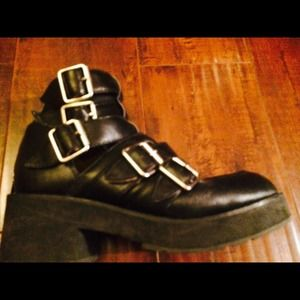 Black buckled Jeffrey Campbell boots