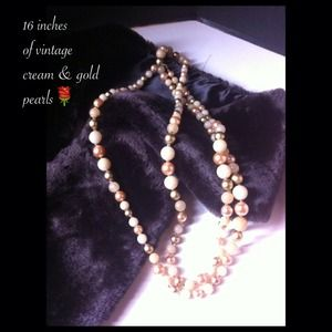 Jewelry - 16 inches of cream and gold vintage pearls.
