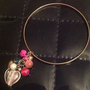 Gold Toned Bangle Bracelet with Charms