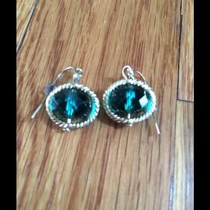 Emerald colored stone earrings with gold halo