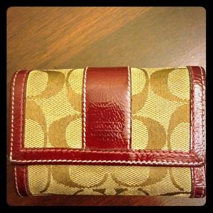 Coach Trifold Wallet. Signature C, Wine colored.