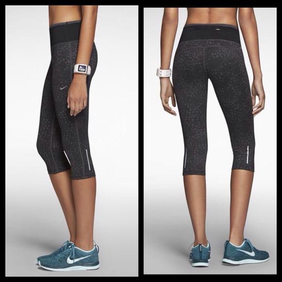 96d089cf78ee9 Nike Women's Printed Epic Run Capris Tights Pants. Nike.  M_53cd9e2514b1e05a69321c78. M_53cd9e2f0b47d33d0e34dae5
