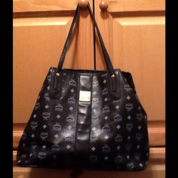 e00bb975754 ... prada phone wallet - MCM Monogram Print Black Tote Bag OS from Jessie s  closet on Poshmark ...