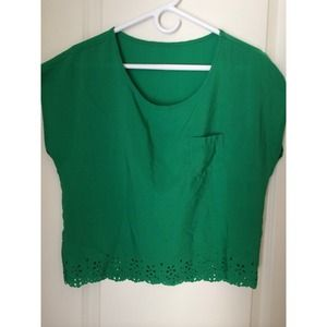 Green top with cut out detail on the bottom